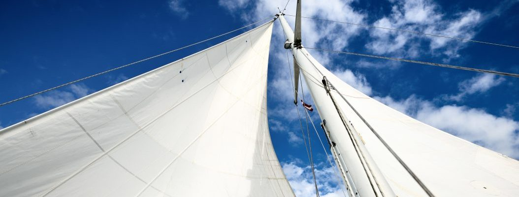 view upwards to the mast of a sailboat