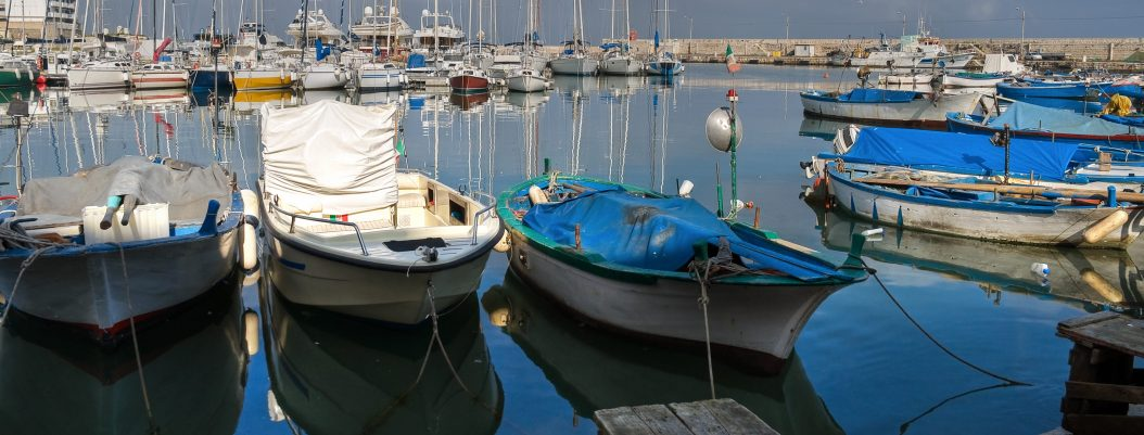 Sailboats in port with canvas covers